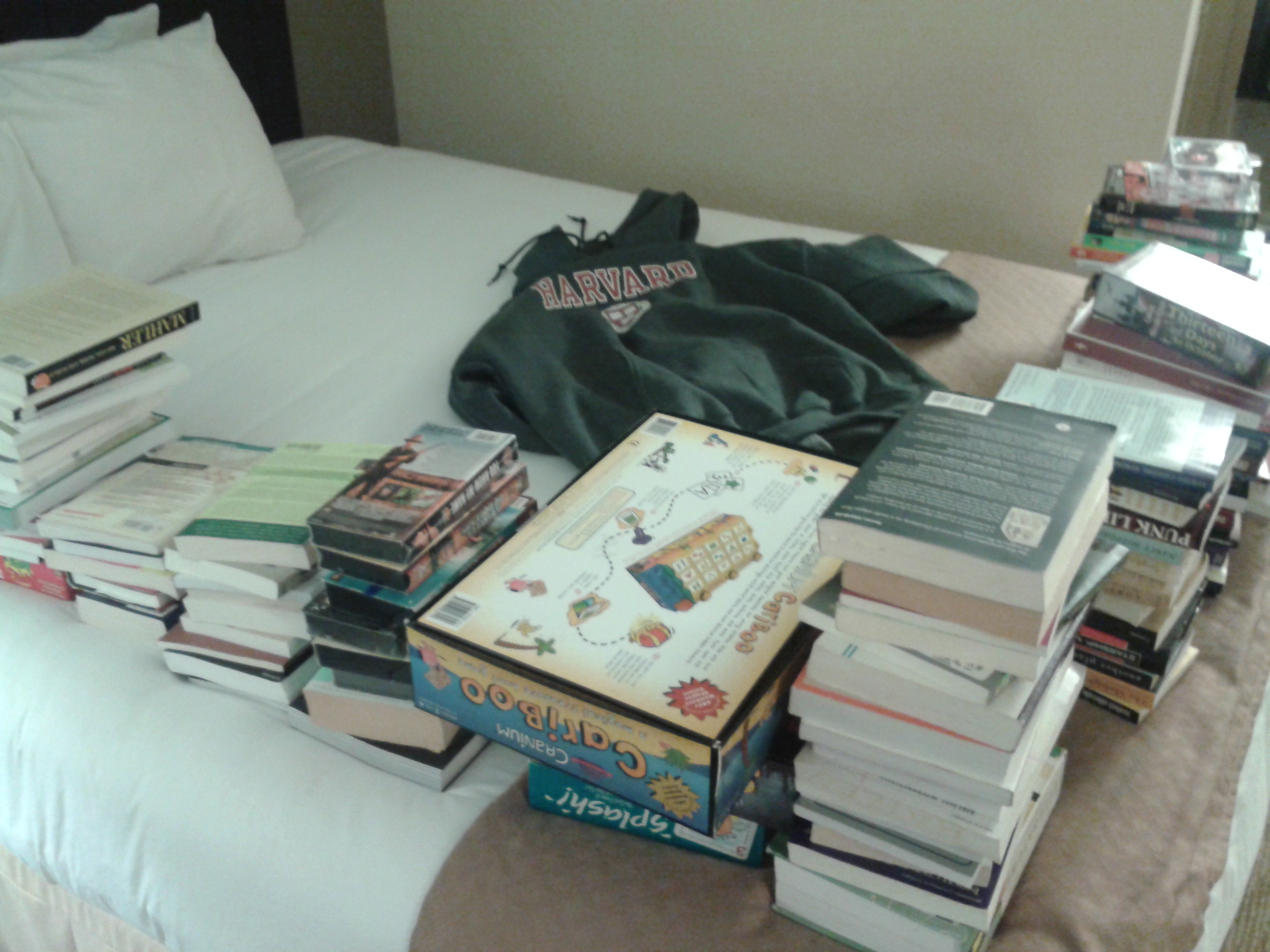 Listing books, VHS, and games in a motel room near Cambridge, Massachusetts.